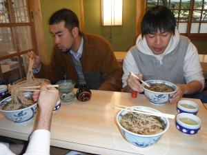 We all sit down to some noodles at a temple. Not some expert use of chopsticks in preparation for slurpage.
